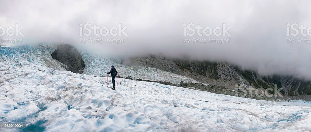 Panoramic of Climber on Franz Josef Glacier in New Zealand stock photo