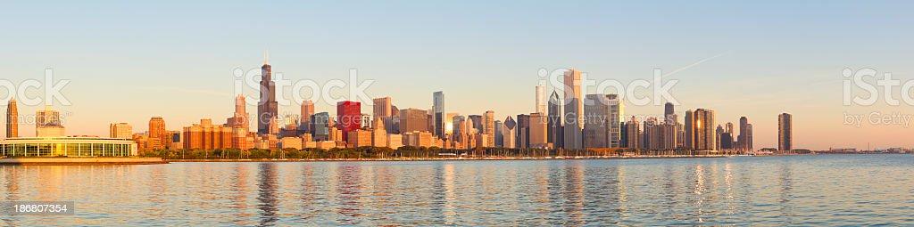Panoramic of golden sunrise across Chicago skyline stock photo