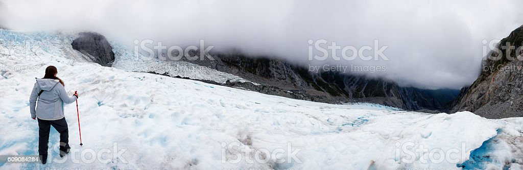 Panoramic of Hiker on Franz Josef Glacier in New Zealand stock photo