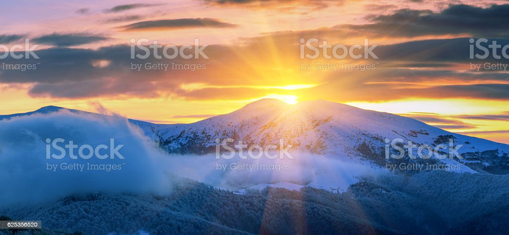 Panoramic of majestic sunrise in the  winter mountains. stock photo
