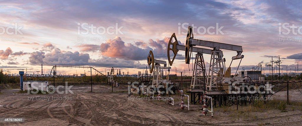 Panoramic oil pumpjack. stock photo