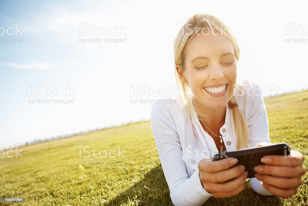 Panoramic outdoor view of woman reading a text message stock photo