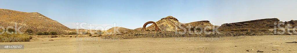 Panoramic photo of western landscape with stone arch. Fort Bravo. stock photo