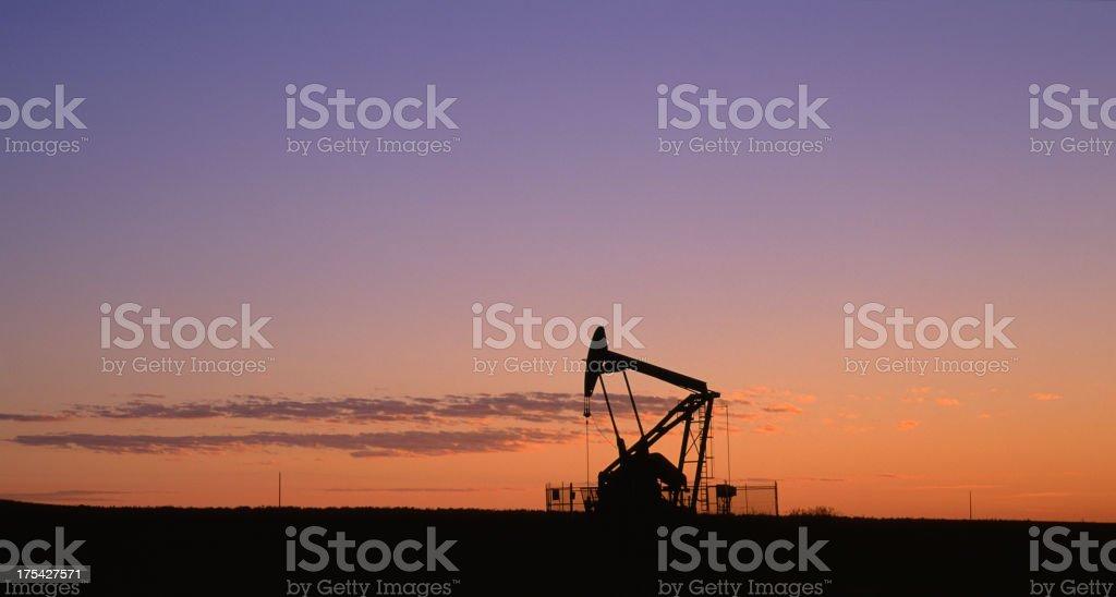 Panoramic Pump Jack Silhouette stock photo