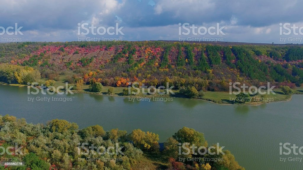 Panoramic shot of autumn forest near the lake or river stock photo