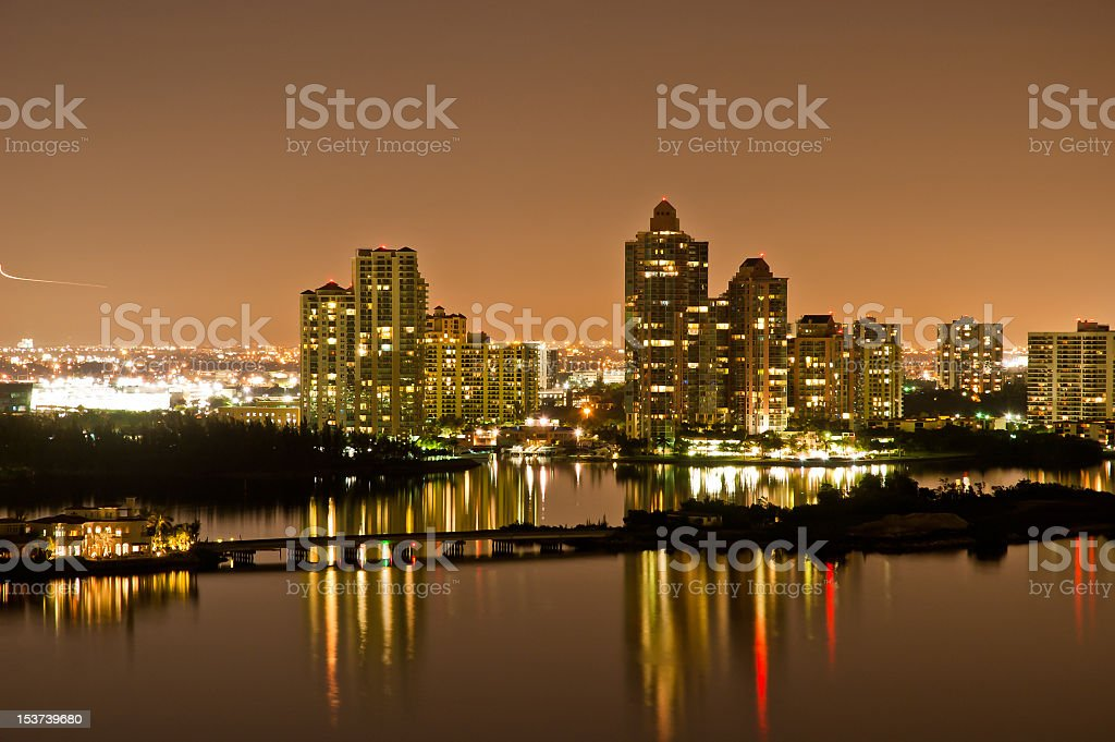 Panoramic shot of coastal city skyline at night stock photo