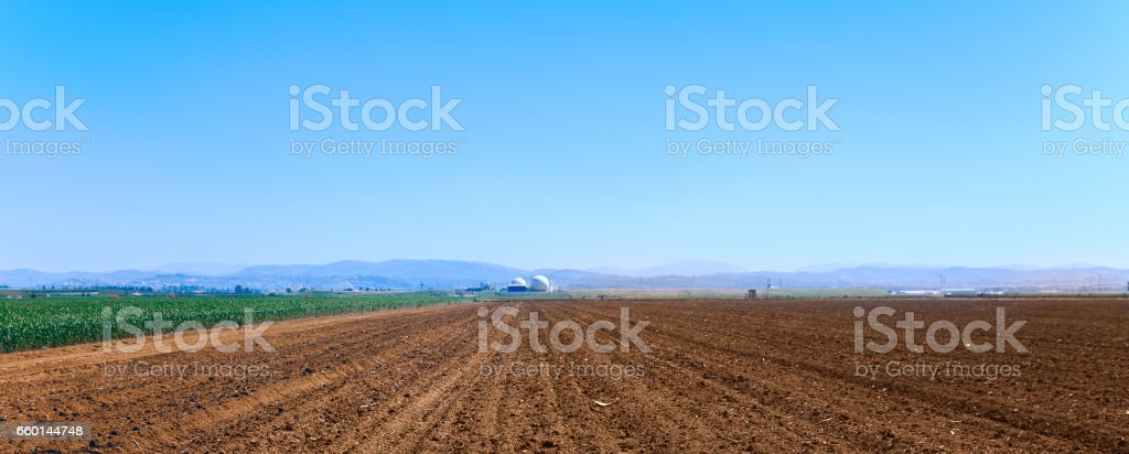 Panoramic shot of plowed field stock photo