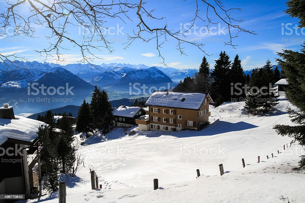 Panoramic skyline view of snow-capped chalets and mountains lake stock photo