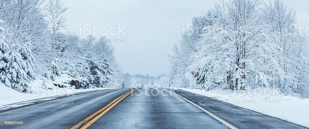 Panoramic Speeding on Rural Winter Blizzard Highway stock photo
