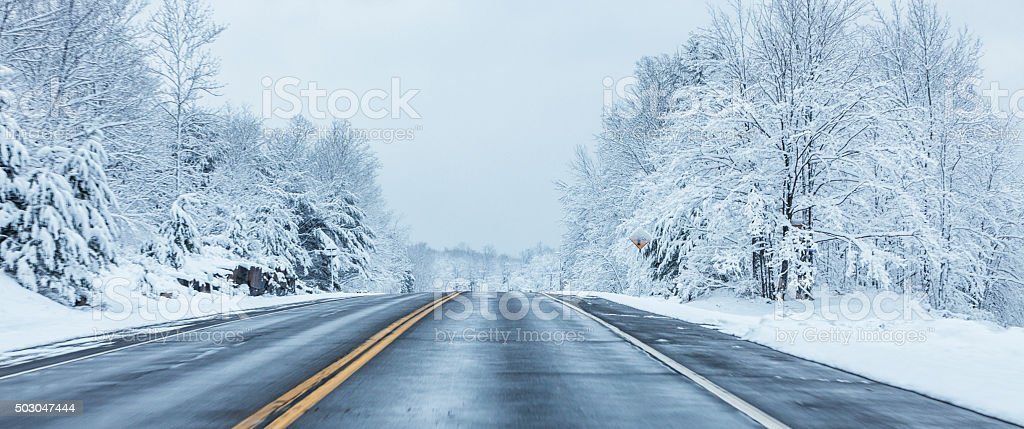 Panoramic Speeding on Rural Winter Blizzard Highway stock photo