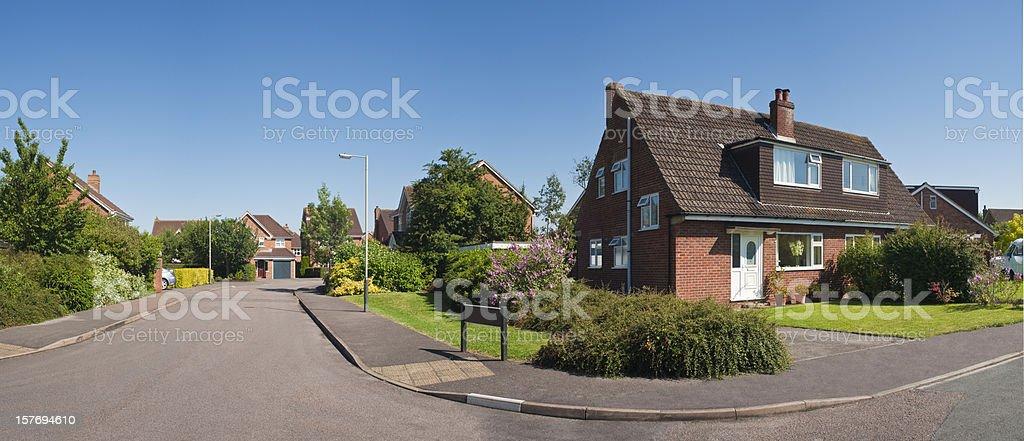 Panoramic suburban street scene in summer. stock photo