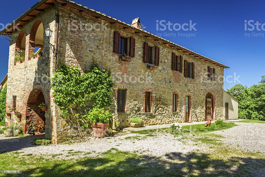 Panoramic summer view of a rural home in Tuscany, Italy stock photo