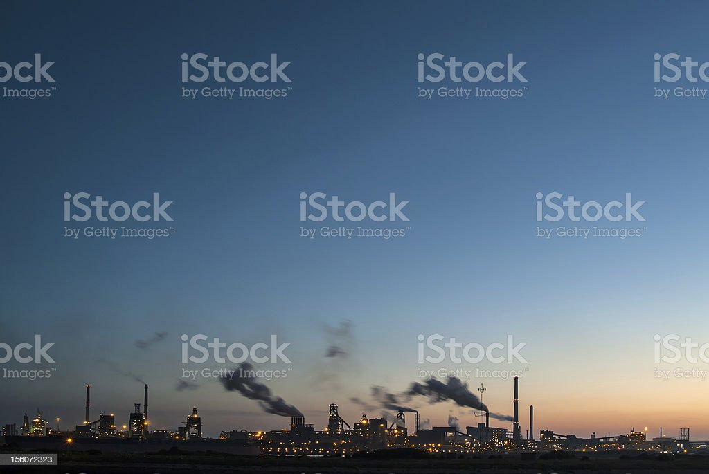 Panoramic sunset view of a large industry area royalty-free stock photo