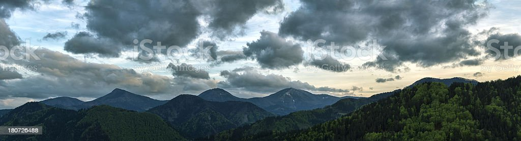 Panoramic sunset view of green valleys and hills royalty-free stock photo