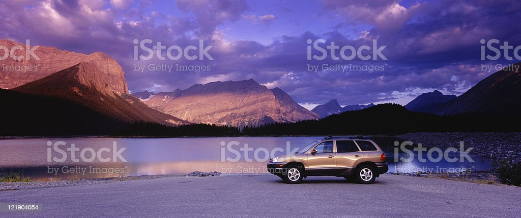 Panoramic SUV and mountains stock photo