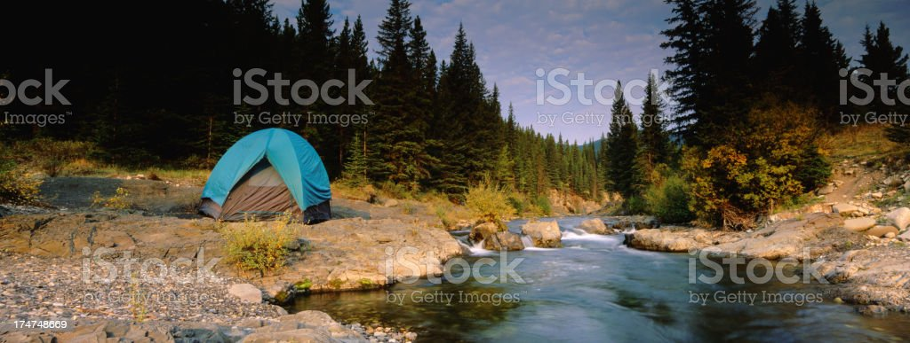 Panoramic Tenting beside a Cascading Brook royalty-free stock photo