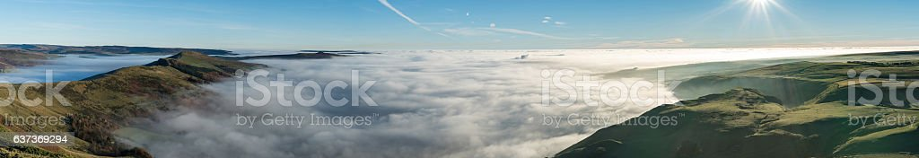 Panoramic view across valley shrouded in mist at Mam Tor stock photo