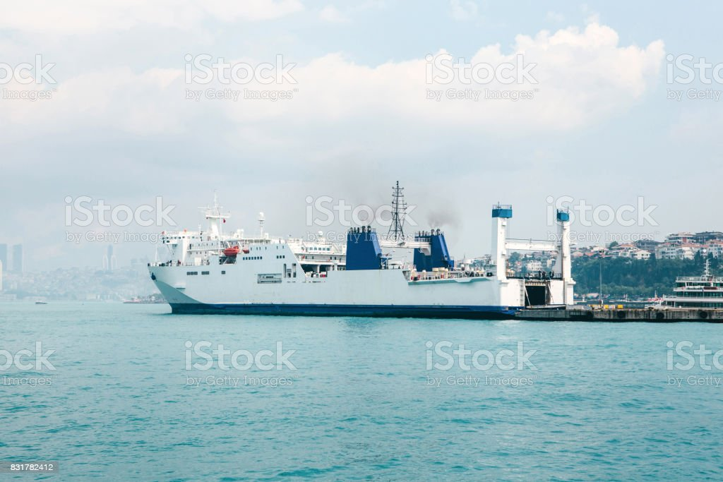 Panoramic view at docked cargo ship. stock photo