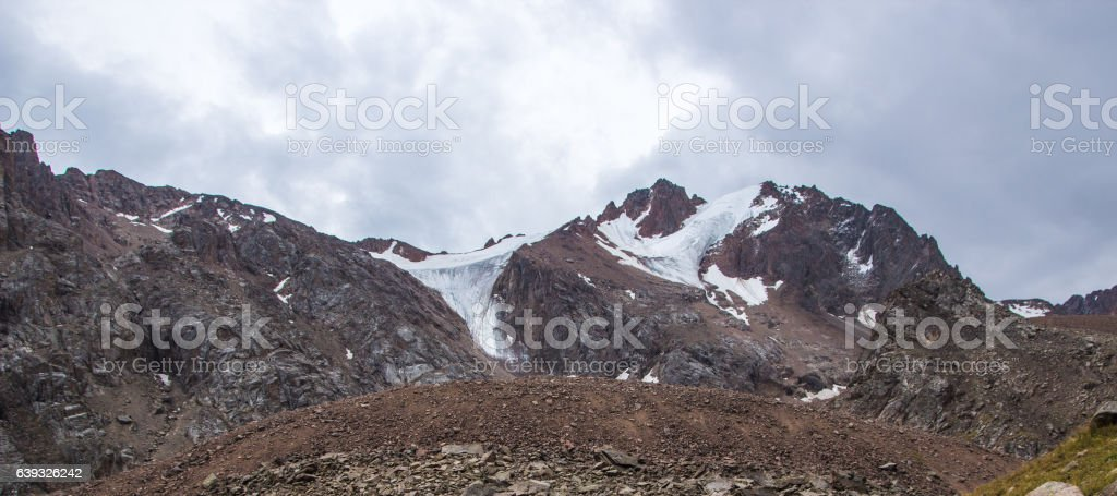 Panoramic view behind Talgar Pass in Tien Shan mountains. Peaks stock photo