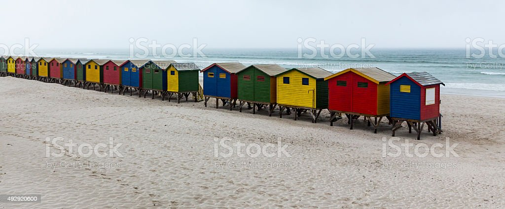 Panoramic view, brightly colored cabanas in fog, Muizenberg, South Africa stock photo