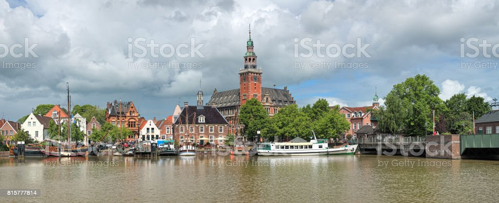 Panoramic view from Leda river on City Hall and Old Weigh House in Leer, Germany stock photo