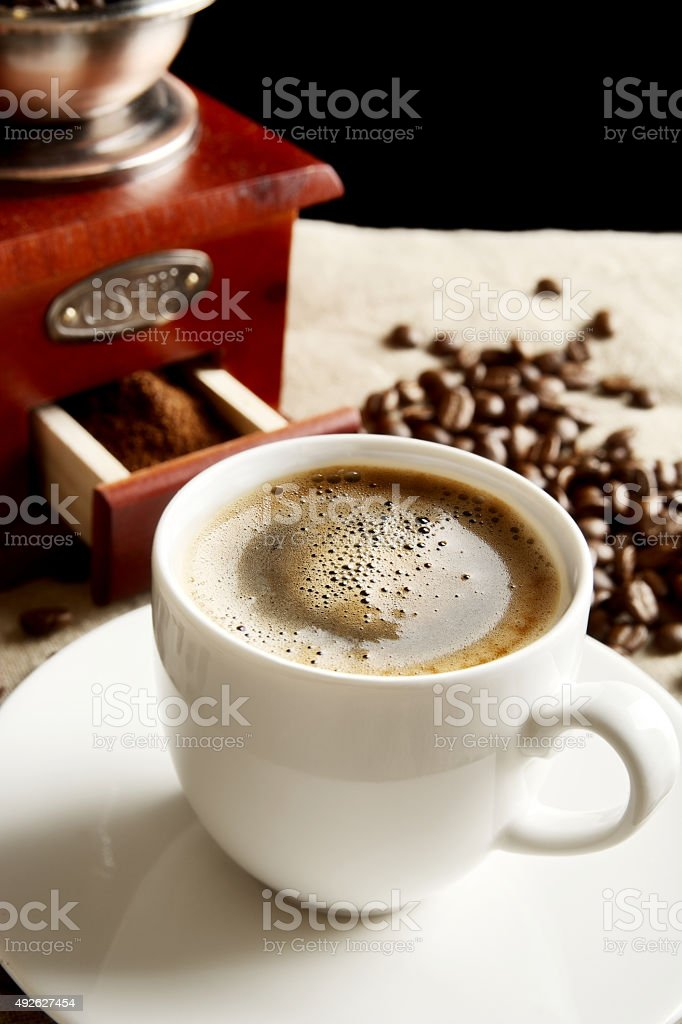 Panoramic view frothy coffee cup with beans on fabric flax stock photo
