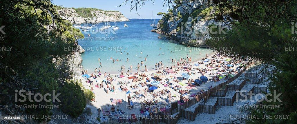 Panoramic view of a crowded beach (Macarelleta - Menorca) stock photo