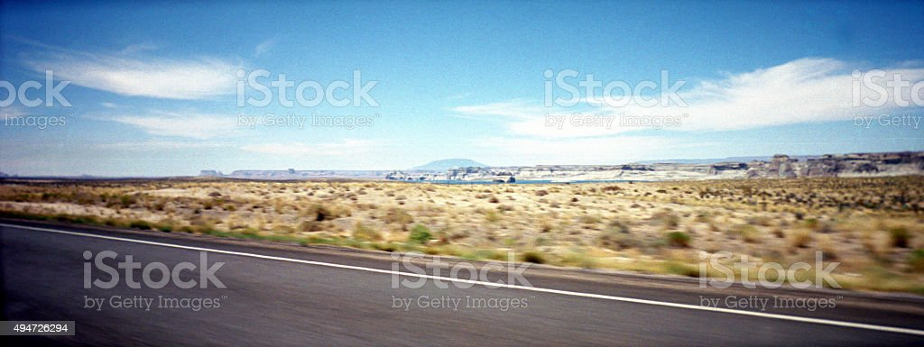 Panoramic view of a desolated road in Nevada stock photo