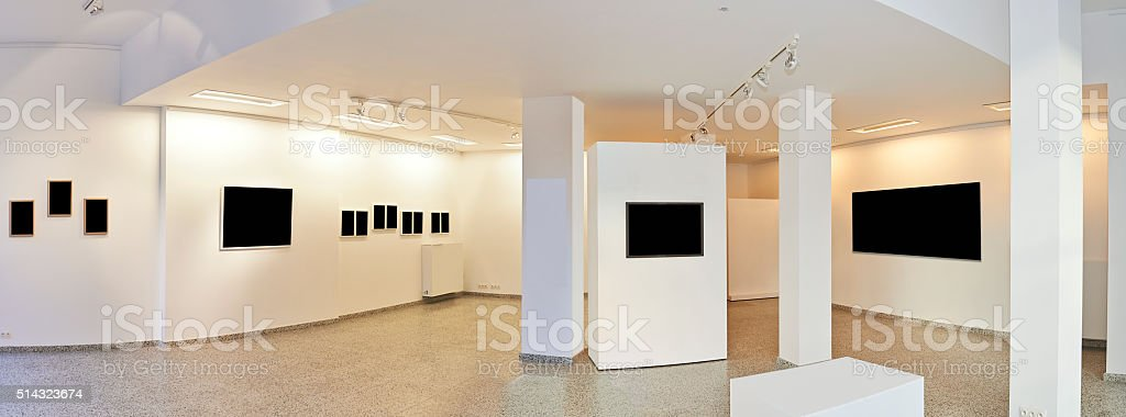 Panoramic view of a Exhibition gallery with museum style lightin stock photo