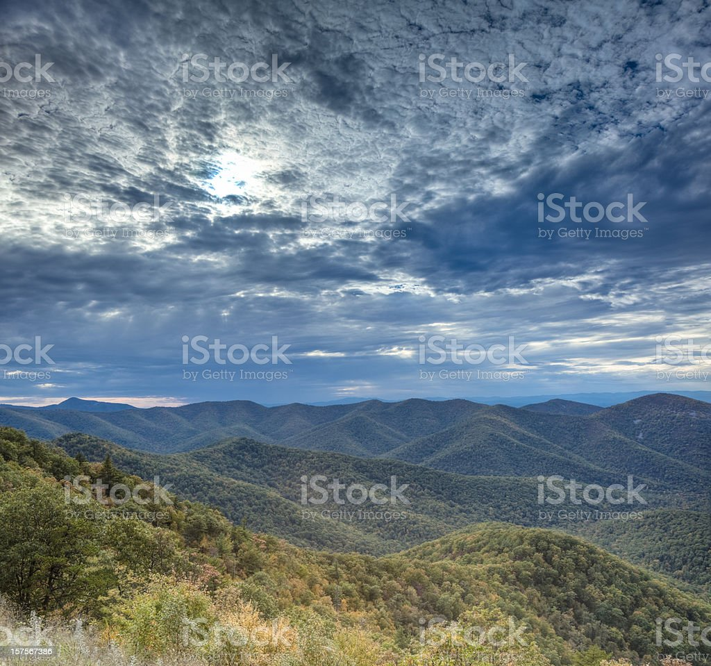Panoramic view of a mountain range and the sky stock photo