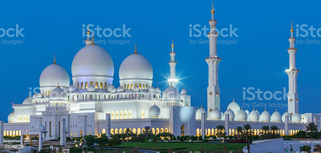Panoramic view of Abu Dhabi Sheikh Zayed Mosque by night stock photo