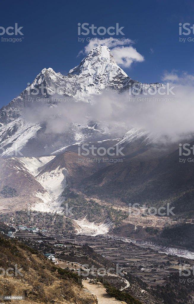 Panoramic view of Ama Dablam peak and himalaya village stock photo
