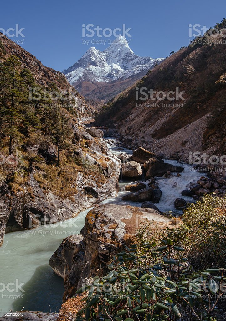 Panoramic view of Ama Dablam peak and himalayan river stock photo