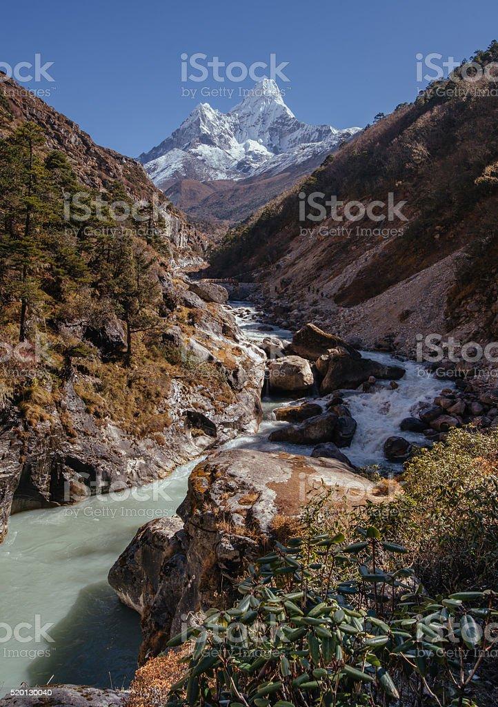 Panoramic view of Ama Dablam peak and himalayan river stock photo