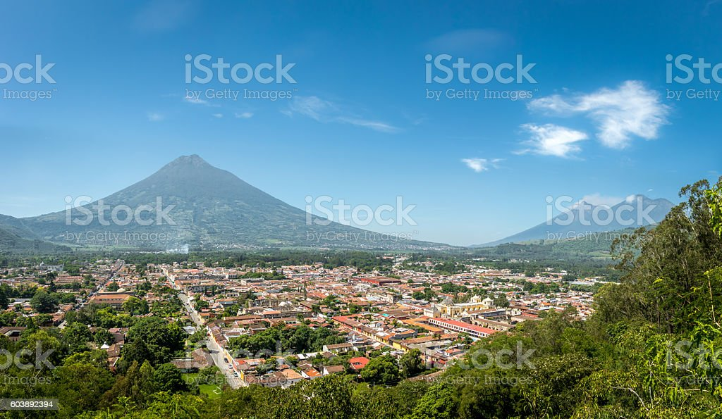 Panoramic view of Antigua Guatemala with the three volcanoes stock photo