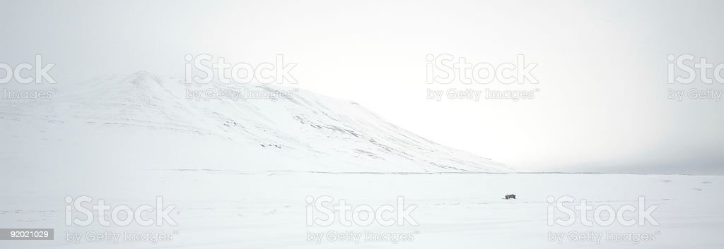 Panoramic View of Arctic Terrain with Winter Cabin