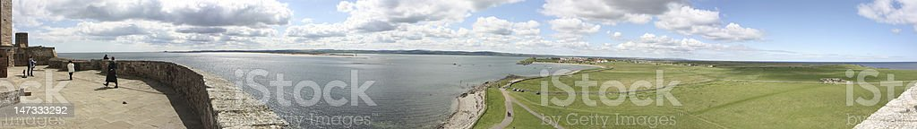 Panoramic view of bay around Lindisfarne Castle stock photo