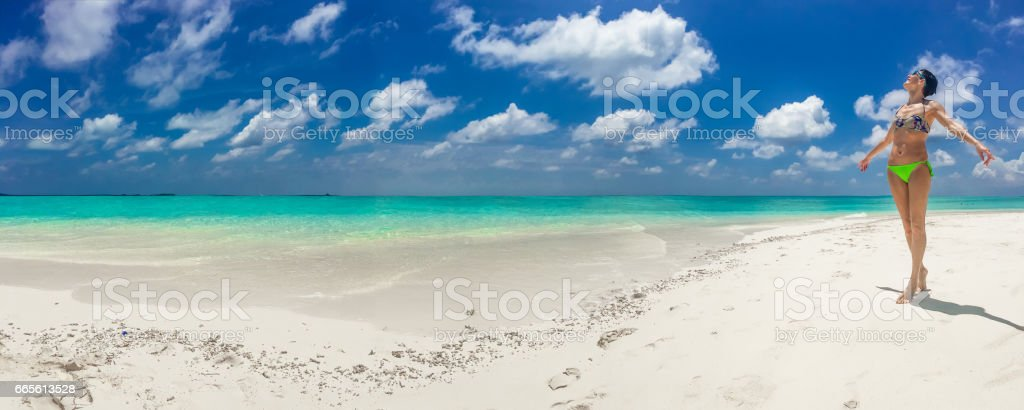 Panoramic View Of Beautiful Woman On Sunny Tropical Beach stock photo