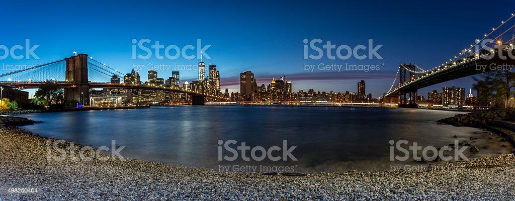Panoramic View of Brooklyn Bridge and Manhattan at night, NYC stock photo