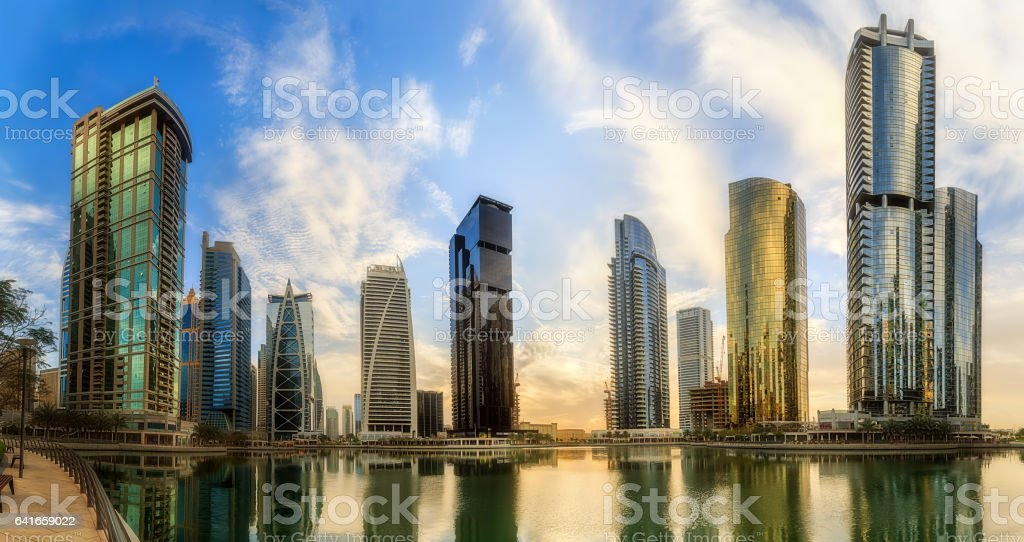 Panoramic view of Business bay and Lake Tower, reflection in a river, UAE stock photo