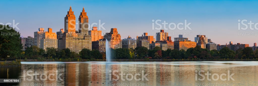 Panoramic view of Central Park West and the Jacqueline Kennedy Onassis Reservoir at dawn. Upper West Side, New York City stock photo