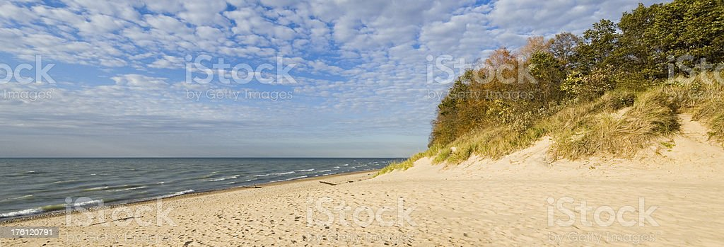 Panoramic View of Deserted Beach in Autumn royalty-free stock photo