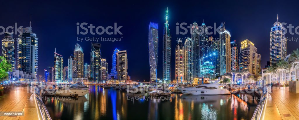Panoramic view of Dubai Marina bay with yacht and cloudy sky, Dubai, UAE. stock photo