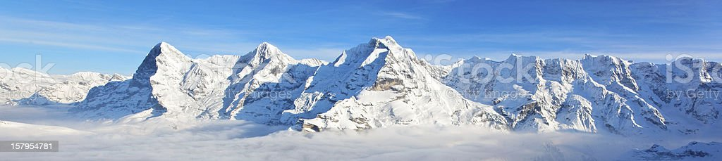 Panoramic view of Eiger, Monch & Jungfrau massif, Swiss Alps stock photo
