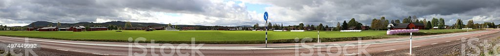 Panoramic view of field and houses near Aeppelbo, Dalarna, Sweden stock photo