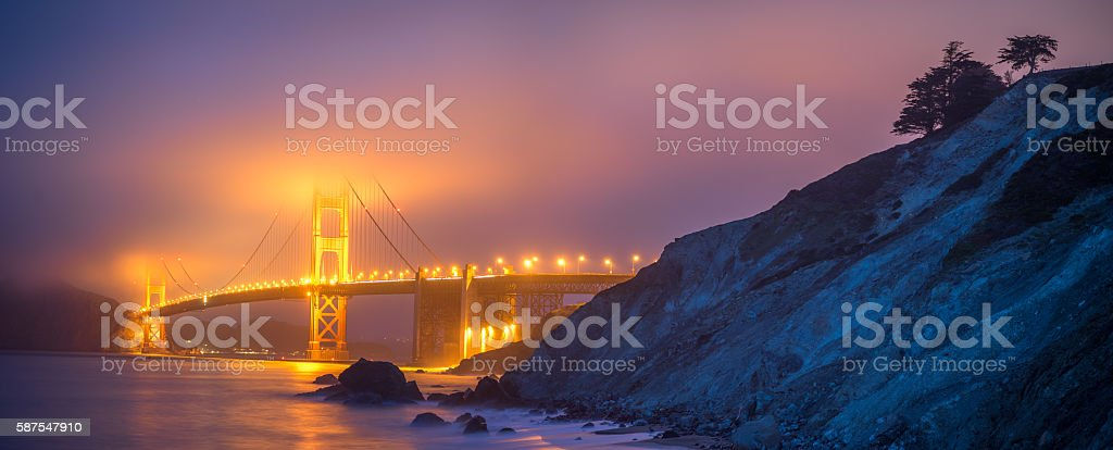 Panoramic View of Golden Gate in Fog from Mashall Beach royalty-free stock photo