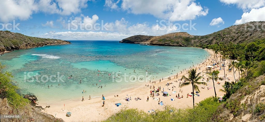 Panoramic view of Hanauma Bay, Hawaii, with beach goers  stock photo