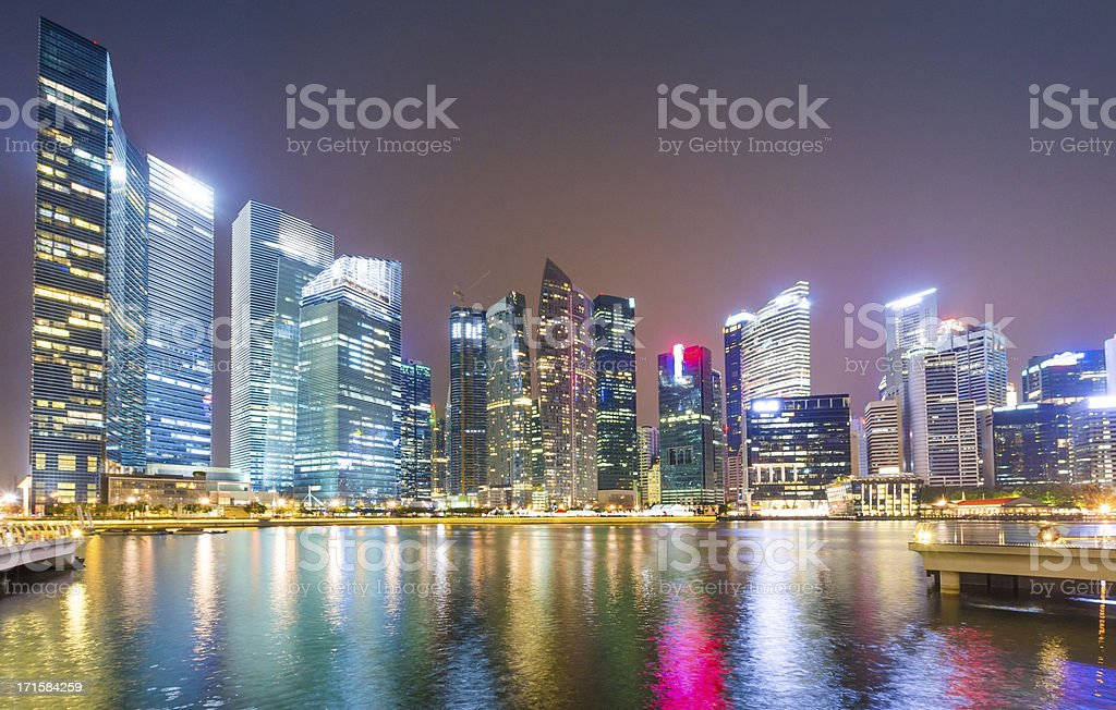 Panoramic view of  High rise buildings at night stock photo