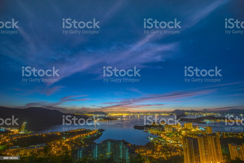 Panoramic view of Hong Kong Island West, West Kowloon and Victoria Harbour, Hong Kong, at dawn stock photo