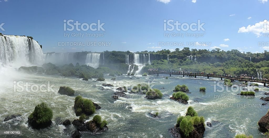 Panoramic view of Iguassu Falls with tourists royalty-free stock photo